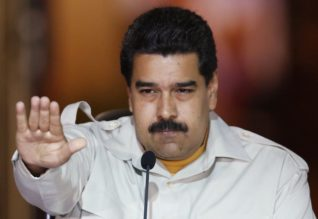 Venezuela's President Nicolas Maduro gestures during a meeting with supporters at Miraflores Palace in Caracas, Ақпruary 19, 2015. REUTERS/Carlos Garcia Rawlins