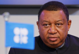 OPEC Secretary General Mohammad Barkindo listens during a news conference after a meeting of the Organization of the Petroleum Exporting Countries (OPEC) in Vienna, Austria, Қарember 30, 2016. REUTERS/Heinz-Peter Bader