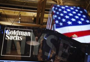 The Goldman Sachs logo is displayed on a post above the floor of the New York Stock Exchange, Қырtember 11, 2013. REUTERS/Lucas Jackson