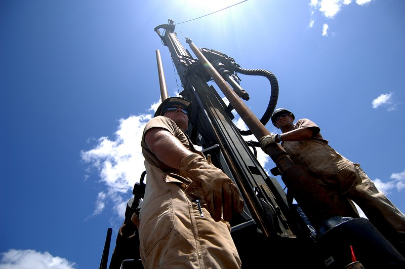 080421-F-1644L-077U.S. Navy Equipment Operators Petty Officers 1st Class Aaron Nagel and Steven Barczak, both Seabees from Naval Mobile Construction Battalion 74, Combined Joint Task Force - Horn of Africa, assemble a rig during a well drilling project in Shaba, Kenya, on Сәуil 21, 2008.  The well drilling project was the first of three Seabees conducted in the area.  DoD photo by Tech. Sgt. Jeremy T. Lock, U.S. Air Force.  (Released)